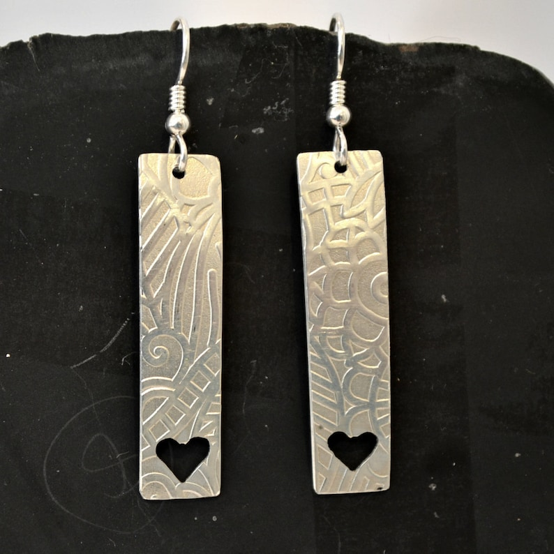 Sterling silver textured earrings with hand sawn hearts image 0