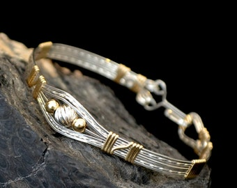RuLaLa    Sterling silver and 14K gold filled wire wrapped bracelet.