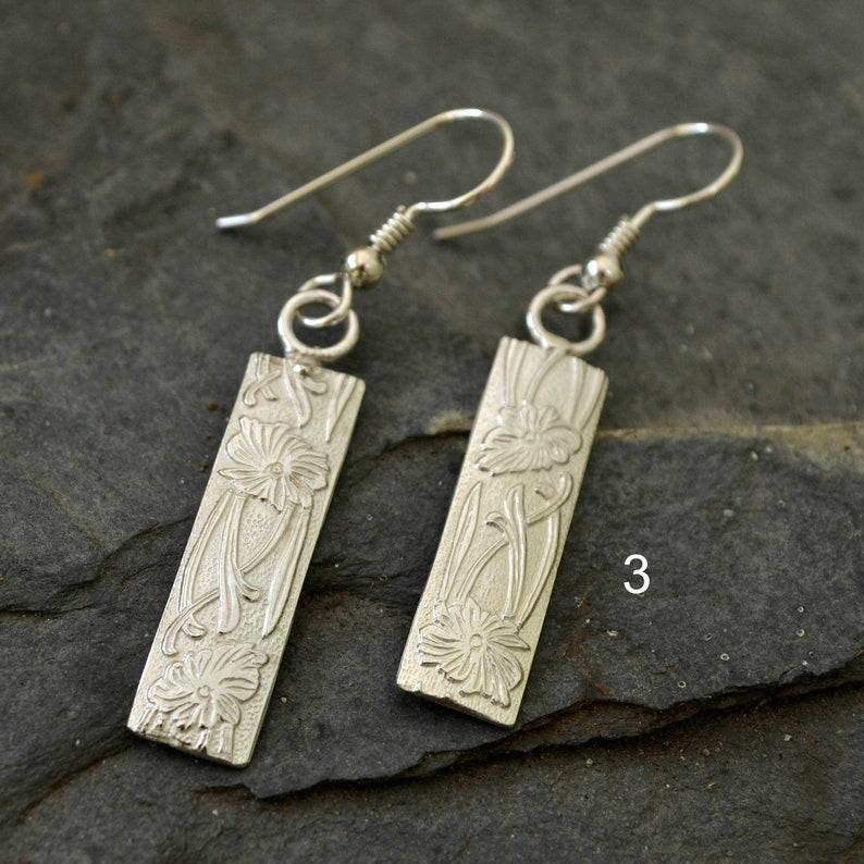 choose 1 2 sterling silver patterned earrings 3 or snakeskin hoops