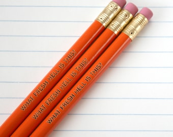 what fresh hell is this engraved pencil set 3 orange pencils. not another irritation, ugh.