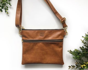 01233fad8a Brown cognac faux leather crossbody front zipped purse with buffalo black  and white plaid interior