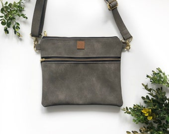 102c708385 Suede gray faux leather crossbody purse with black and white striped  interior