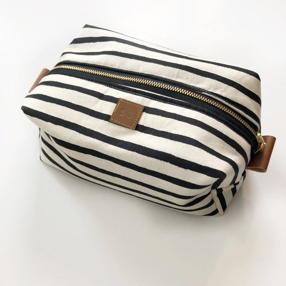 30208544fb9e Black and cream stripe rifle paper print boxy makeup bag with leopard  interior