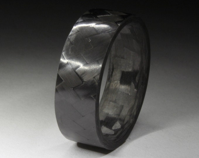 Pure Carbon Fiber ring with a Unidirectional Strip and a Blue Glow Core.
