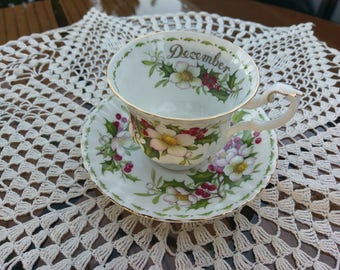 Vintage 1970's Royal Albert teacup and saucer flower of the month series, Christmas Rose, made in England.