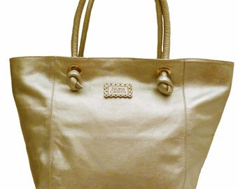 Leather oversized tote gold. Purse, handbag, hobo. Silky linen. Laptop bag. Very spacious, perfect for trips and just your day to day tote
