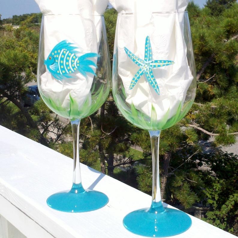 Fish and starfish hand painted wine glasses.