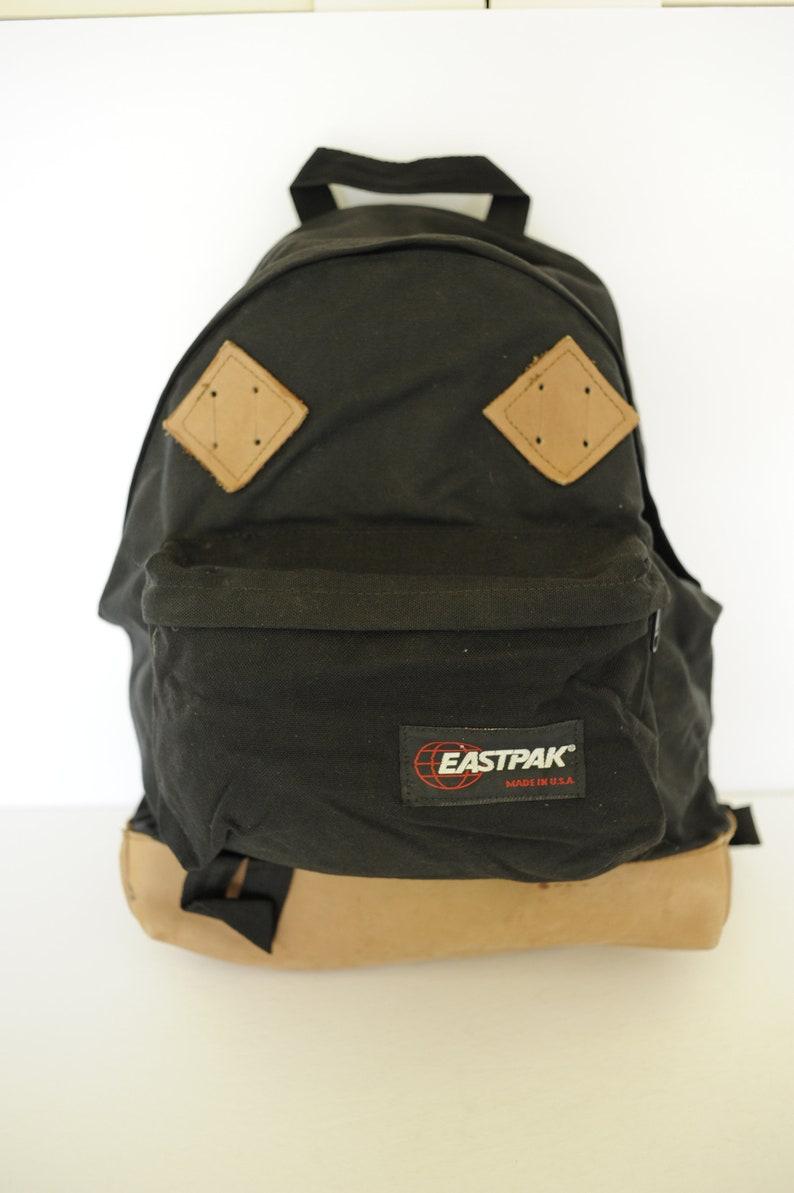 Vintage Eastpak Black Canvas Backpack with Leather Bottom