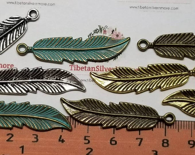 8 pcs per pack 43x10mm Feather Charm in color to choose Lead Free Pewter