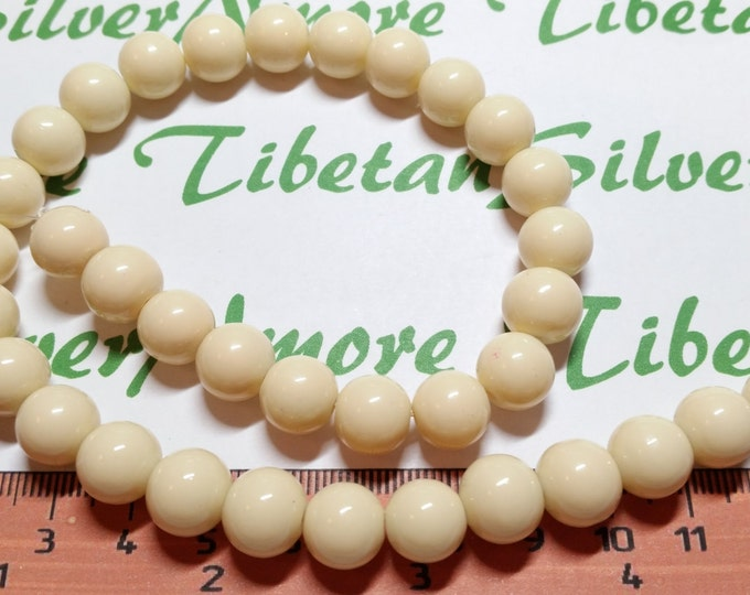 2 strands of 10 mm Ivory or Creamy Bone Color Glass Beads 40 beads each strand