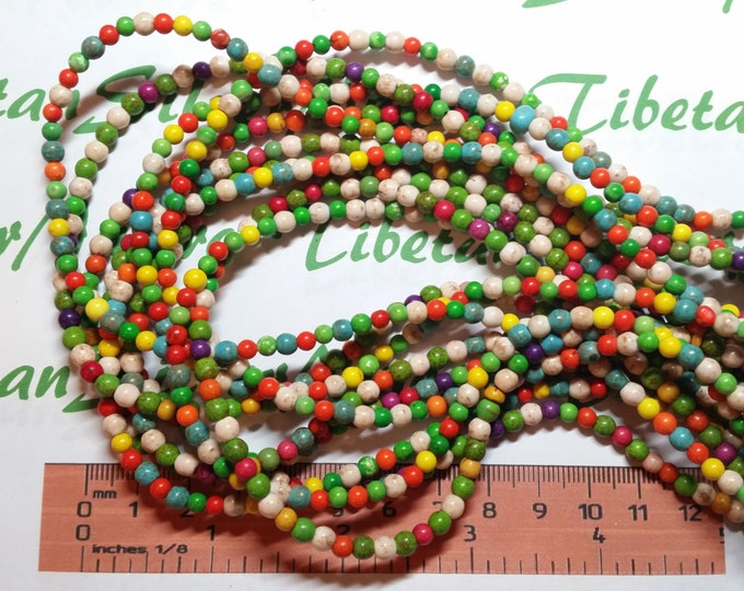 16 inches of 4mm Round Multi-color Greenish Dyed Magnesite Beads.