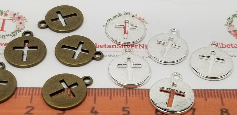 14 pcs per pack of 14mm Plain cut out Cross Coin Pendant in image 0