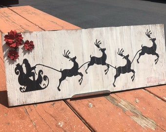 Santa and Reindeer silhouette w/ poinsettia Sign