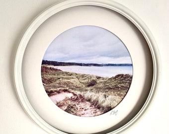 Round Framed print, Oxwich Bay, Gower. Porthole framed vintage effect photographic, coastal art print by Rebecca Jory.