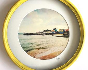 Porthole Framed print, Tenby Harbour, Saundersfoot. Round metal framed vintage effect photographic art print by Rebecca Jory.
