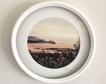 Porthole Framed Print, Three Cliffs Bay, Gower. Vintage effect photographic art print by Rebecca Jory.