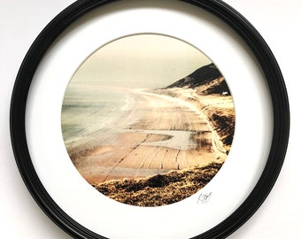 Porthole Framed Print of Rhossili Bay, Gower. Wall art. Round, metal framed Vintage effect photographic art by local artist Rebecca Jory.