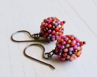 Jeanette - handmade artisan bead earrings in orange magenta pink medley with sterling silver earwires