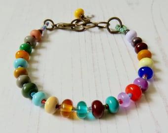 Handmade rainbow bead bracelet - Farve - handmade bead bracelet with artisan lampwork bead multicolour - Songbead uk