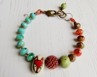 Handmade artisan bead bracelet - Dusk - artisan bead bracelet in orange turquoise green with fox - Songbead, UK, narrative jewelry