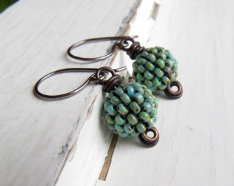 Handmade turquoise bead earrings - handwoven Picasso blue-green glass bead earrings with oxidised silver loops - Songbead UK OOAK