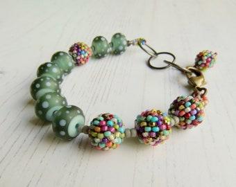 Handmade turquoise bead bracelet - Sweetie Jar - handmade artisan bead bracelet in grey with multicolour accents - Songbead, UK,