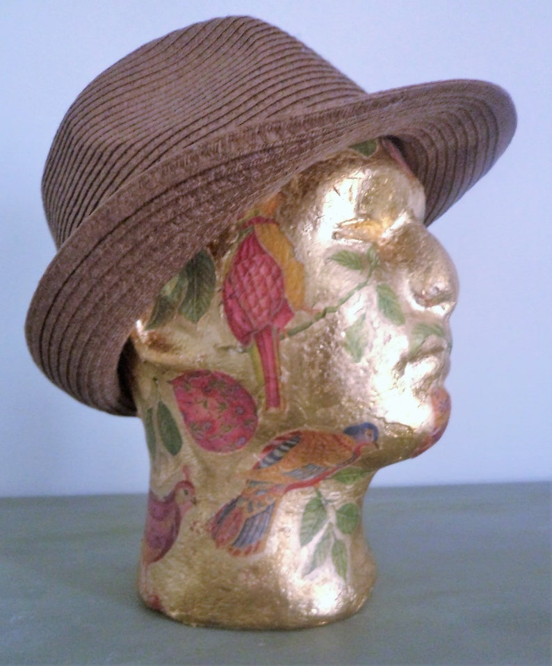 hat stand with gold leaf and birds of paradise Male mannequinn
