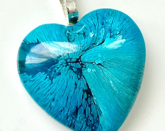 Turquoise and blue heart-shaped domed resin pendant with a wide silver heart shaped bail