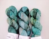Labradorite: hand dyed tonal and speckled Merino sock yarn by Star Fiber Studio