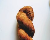 Goldsturm: hand dyed tonal Merino sock yarn by Star Fiber Studio