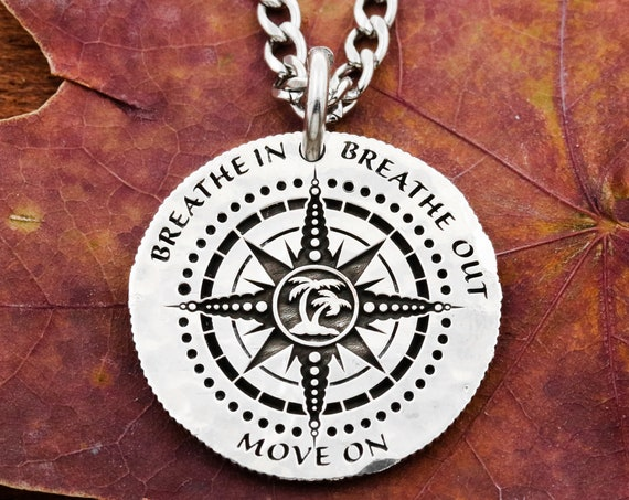 "Silver Compass Necklace, Advice Charm, Back Side Etching ""If A Hurricane Doesn't Leave You Dead It Will Make You Strong"""