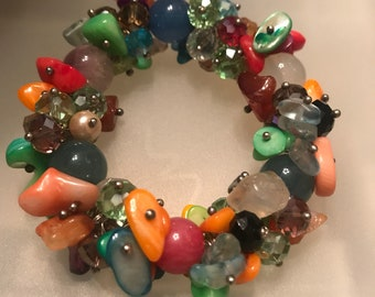 Stretchy beaded bracelet with multi colors different kind of beads crystals and Cora and stones