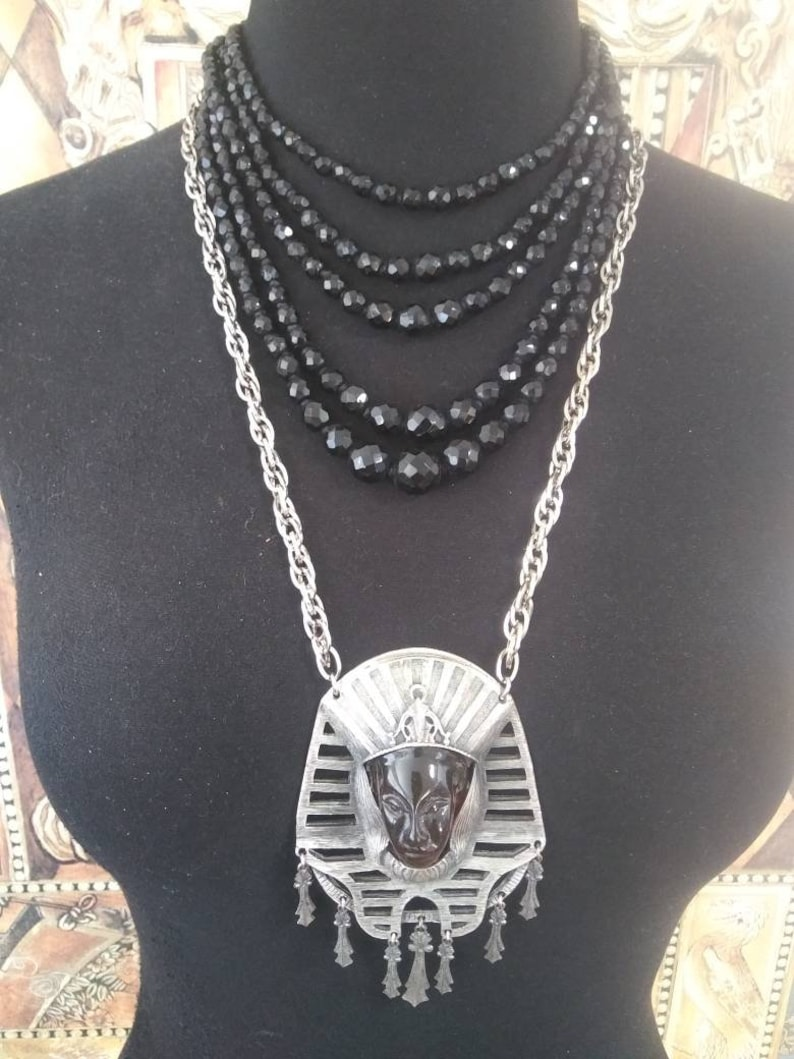 Egyptian Revival faux Amber silvertone metal large pendant mid-century necklace