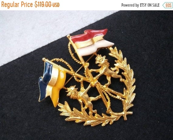 Vintage collectible crest brooch, dragon flag pin
