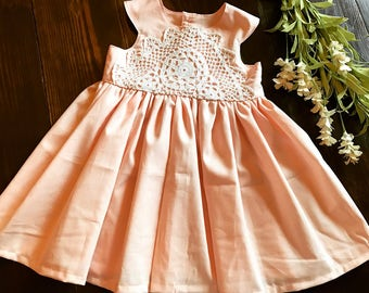 Hannah dress - light peach solid cotton and white crochet lace bodice baby girl's dress with round neckline and cross back