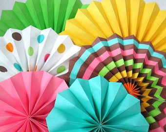 Hanging Paper Fans Rosettes and Hanging Pinwheels party decoration for a birthday party bat mitzvah baby shower bridal shower or wedding