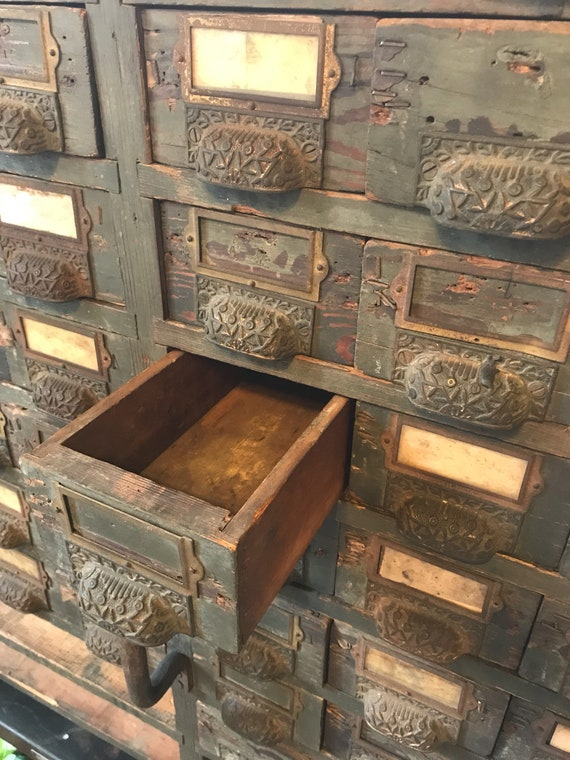 1900s Store Piece w 69 Drawers w Decorative Cast Iron Pulls Heavy Wood