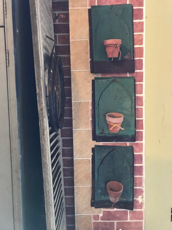 Gothic planters made ftom vintage roof tins Repurposed DIY