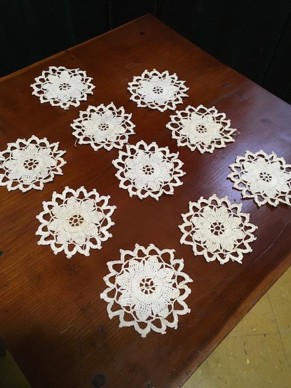 10 small flower doilies
