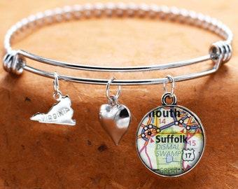 5 3//4 inch Oval Eye Hook Bangle Bracelet with a St Alexandra charm.