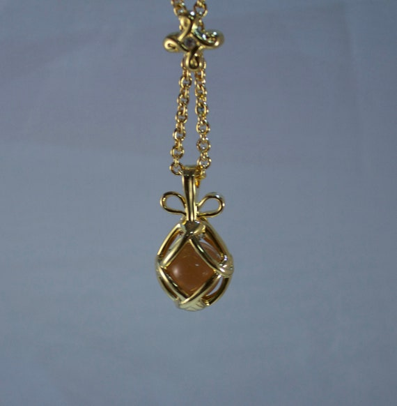 Joan Rivers Amber Glass Egg Pendant and Necklace