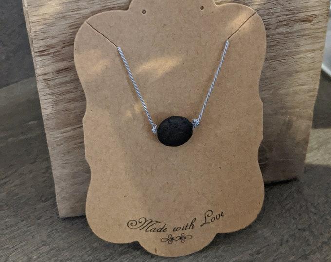 Lava Stone Necklace on Silk Cord - One Black Flat Lava Stone Bead - Zen Jewelry - Grounding Stone Jewelry - Gift for Yogi