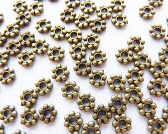 100 Spacer Ø4mm, bronze, Metallperlen