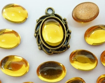 12 glass cabochons, 8x6mm, yellow, oval