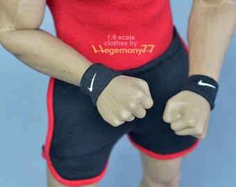 A pair of 1/ 6th scale black wristbands with logo - handmade miniature