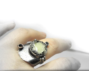 sterling silver ring with amber and black and white granule connected with resin, contemporary jewelry, sculptured, art jewelry, oxidized