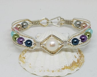 Silver and gold bracelet, wire wrapped
