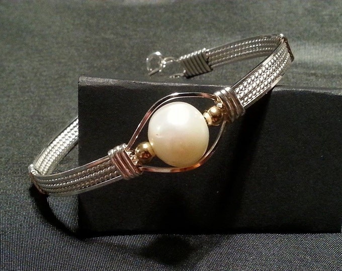 Large Baroque fresh water Pearl wrapped in Sterling Silver and gently kissed by two 14kt GF Beads.