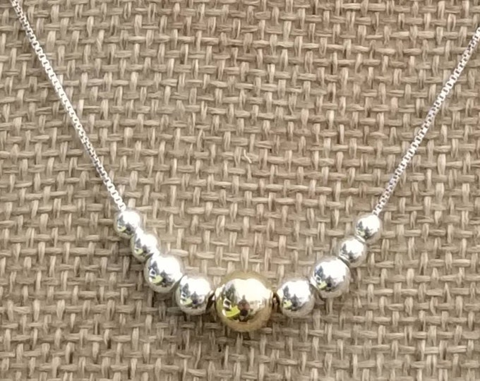 Simple and Pretty: A Sterling Silver chain and beads with a 14kt Gold filled focal bead.