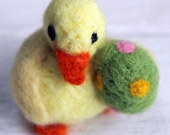 Little yellow needle felted duck with green spotty egg